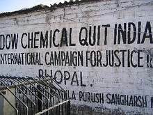 "Painted protest on wall. Reads ""Dow chemical quit India"""