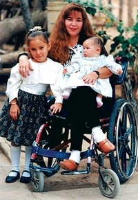Woman in wheelchair with two children