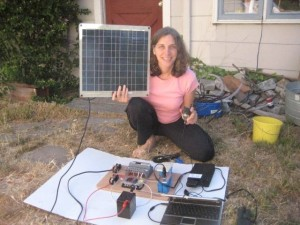 Woman holding a solar panel