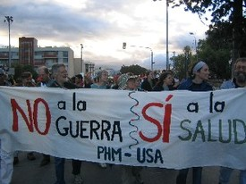 "People's Health Movement March in Cuenca, Ecuador. Banner reads ""No a la guerra, si a la salud"""