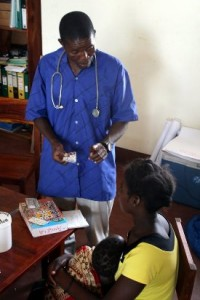 health worker with woman and baby in Mozambique
