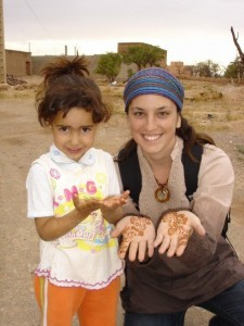 Janelle with a little girl in rural setting
