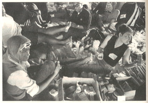 1965: Dr. June Finer and other medics  tend to the sore feet of protesters at Selma